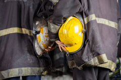 Workers Holding Helmets At Fire Station Royalty Free Stock Image