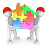 Workers holds the house puzzle. Stock Photos