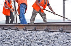 Workers In Orange Vests Royalty Free Stock Photos