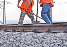 Workers In Orange Vests Royalty Free Stock Images