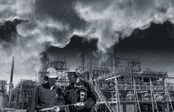 Workers and industry pollution Stock Photos