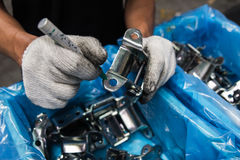 Workers inspect automotive parts. Workers inspect automotive and parts Royalty Free Stock Photography