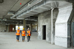 Workers with Inspector in Basement Floor at Construction Site Royalty Free Stock Photography