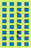 Workers install air conditioners on the wall Stock Photos