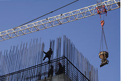 Workers install armature. Crane on construction of building royalty free stock images