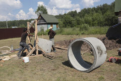 Workers install concrete rings in the well royalty free stock photography