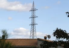 Electrical high tension tower in Mallorca. Workers install electrical high tension towers in Mallorca. The construction of the towers produces a large impoct in Royalty Free Stock Image