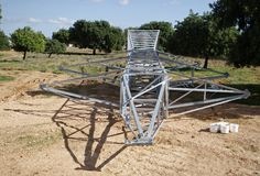 Electrical high tension tower in Mallorca. Workers install electrical high tension towers in Mallorca. The construction of the towers produces a large impoct in Stock Images