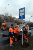 Workers install traffic sign on street of Moscow. Royalty Free Stock Images