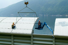 Workers during the installation of noise barriers on the highway Royalty Free Stock Images