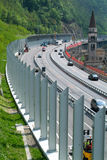 Workers during the installation of noise barriers on the highway Stock Images