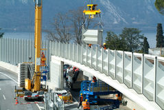 Workers during the installation of noise barriers on the highway Royalty Free Stock Photos