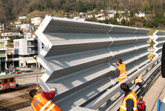 Workers during the installation of noise barriers on the highway Royalty Free Stock Photography