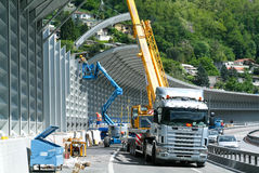 Workers during the installation of noise barriers on the highway Stock Photos