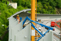 Workers during the installation of noise barriers on the highway Stock Image