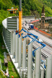 Workers during the installation of noise barriers on the highway Royalty Free Stock Photo
