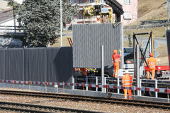 Workers during the installation of noise barriers on the railway Stock Photography