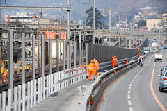 Workers during the installation of noise barriers on the railway Royalty Free Stock Image