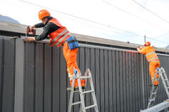 Workers during the installation of noise barriers on the railway Royalty Free Stock Photography