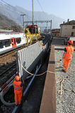 Workers during the installation of noise barriers on the railway Stock Photos