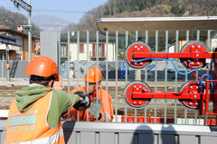 Workers during the installation of noise barriers on the railway Stock Image