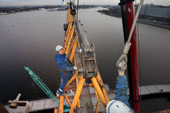 Workers installers fixed working construction boom hoisting tower crane royalty free stock images