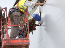 Workers installing facade panels Stock Photography