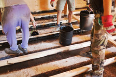 Workers installing a house foundation Stock Photography