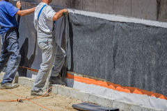 Workers installing wall insulation 2 Royalty Free Stock Images