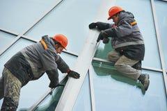 Workers installing window Stock Image