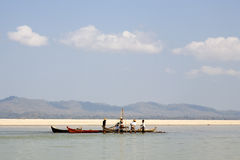 Workers on the Irrawaddy River. Workers dredging the shallow waters of the dry season Irrawaddy River in Myanmar Stock Photography