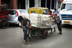Workers, Laborers Haul Goods to Market in India. A group or workers or laborers haul goods to market in India. Much of the work is still done by manual labor Royalty Free Stock Images