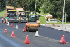 Workers laid asphalt on road Royalty Free Stock Photo