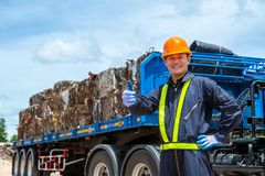 Workers in landfill dumping, Garbage engineer, recycling, wearing a safety suit Standing in front of the truck, the concept for. The safety of the recycling royalty free stock photo
