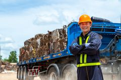 Workers in landfill dumping, Garbage engineer, recycling, wearing a safety suit Standing in front of the truck, the concept for. The safety of the recycling royalty free stock photos