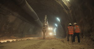 Workers in a Large scale tunnel construction project stock video