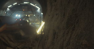 Workers in a Large scale tunnel construction project. Large scale tunnel construction project with workers and heavy tools stock video footage