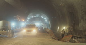 Workers in a Large scale tunnel construction project stock video footage