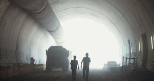 Workers in a Large scale tunnel construction project stock footage