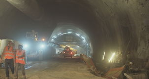 Workers in a Large scale tunnel construction project. Large scale tunnel construction project with workers and heavy tools stock video