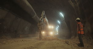 Workers in a Large scale tunnel construction project. Large scale tunnel construction project with workers and heavy tools stock footage
