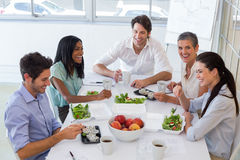 Workers laughing while enjoying lunch break Royalty Free Stock Photo