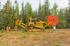 Workers laying fibre optic cable in the northwest territories Royalty Free Stock Images