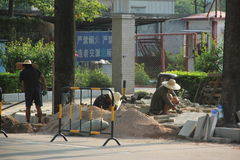 The workers are laying roads in shenzhen stock photos