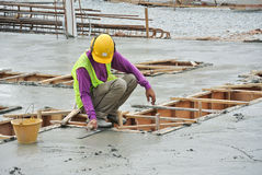 Workers leveling the wet concrete Stock Photo