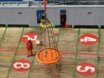 Workers are lifted by the crane to the offshore platform. Transfer crews by personal basket from the platform to crews boat stock photos
