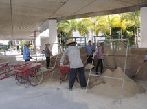 The workers are loading the sand Royalty Free Stock Photo