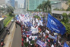 Workers long marched in Jakarta. Jakarta, Indonesia, July 12, 2012. Thousands of workers marched in Jakarta to protest against low wages Royalty Free Stock Image