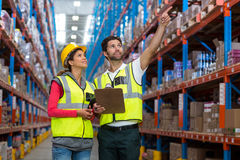 Workers are looking shelves Royalty Free Stock Photo