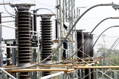 Workers maintenance sub station. Workers maintenance an electrical power sub station Royalty Free Stock Image